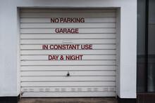 No Parking Sign On A Garage Door