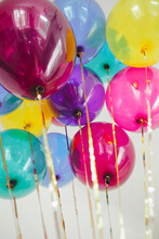 Balloons In Many Colors Flying Together With Gold Sequin Strings
