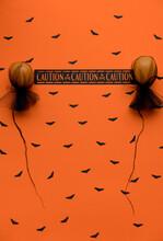 Halloween Warning Message Between 2 Orange Balloons On A Bat Pattern