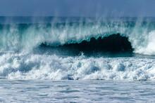 Waves Breaking On The Beach Ne...