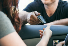 Driving: Father Hands Key Fob To Teen Girl