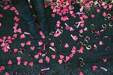 Woman Standing On Heart-Shaped Confetti