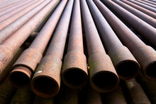 Stack Of Rusty Tubes And Drill...