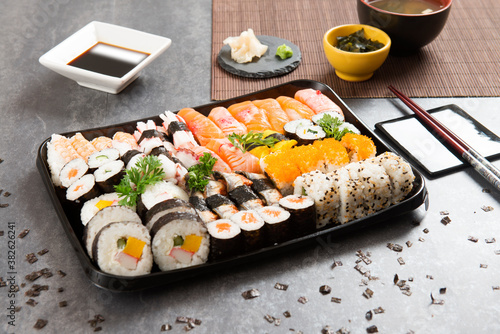 Fototapeta Japanese sushi food, maki roll, sashimi, avocado, rice shrimps. Mix sushi, raw food. obraz