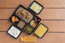 Take Away Lunch Box Meal Of Arabic Food Included Starter, Main Course, Dessert And Drink. Order Lunch Box. Stay At Home And Eat Healthy. Cope Space.