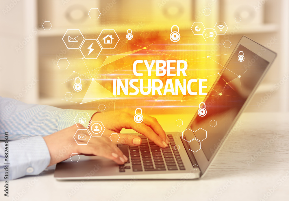 Fototapeta CYBER INSURANCE inscription on laptop, internet security and data protection concept, blockchain and cybersecurity