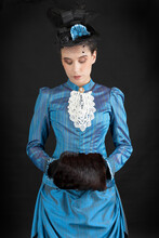 A Young Victorian Woman Wearing An 1880s Ensemble