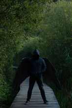 Man With Black Wings In Jeans ...