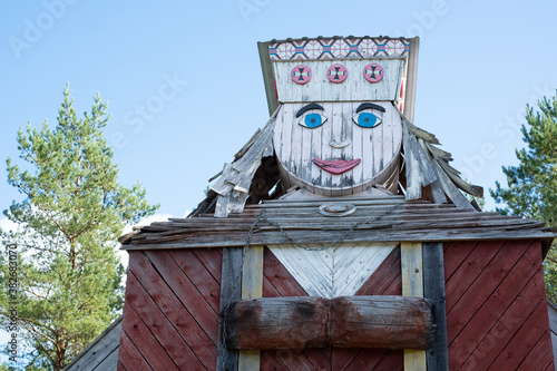 Giant wooden dolls in folk costumes rebuilt from windmills Fotobehang