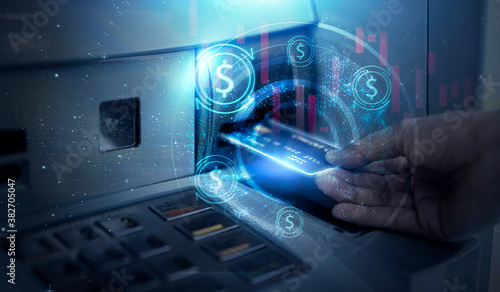 Fototapeta Modern technology banking money financial management saving funds inserting credit card into ATM machine withdrawing cash, bank account information transaction transfer, futuristic graphics and icon obraz