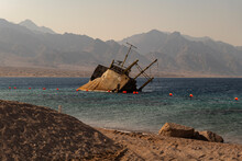 Sunset View Of Shipwreck In The Gulf Of Aqaba Off The Saudi Arabian Coast, Haql Province