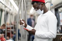 Black Millennial Man In Red Ha...