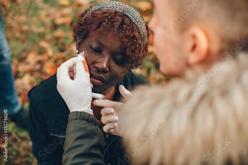 Guy help a woman Canvas Print