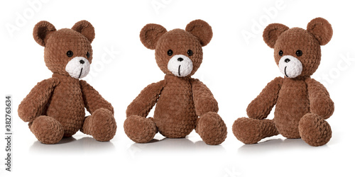 Knitted toy. Brown bear on white background. Three position. Full depth of field. With clipping path. #382763634