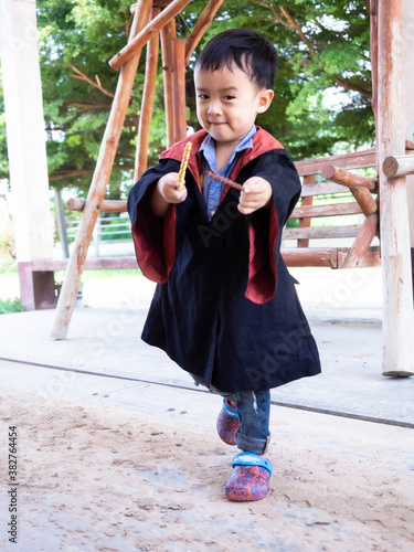 Obraz na plátne Asian children girl in witch dress Casting magic