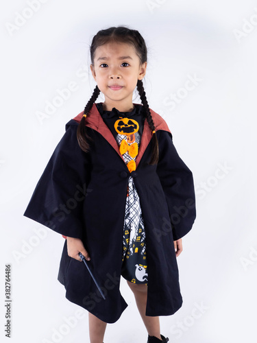 Asian children girl in witch dress costume Riding a broom for Halloween decorati Canvas Print