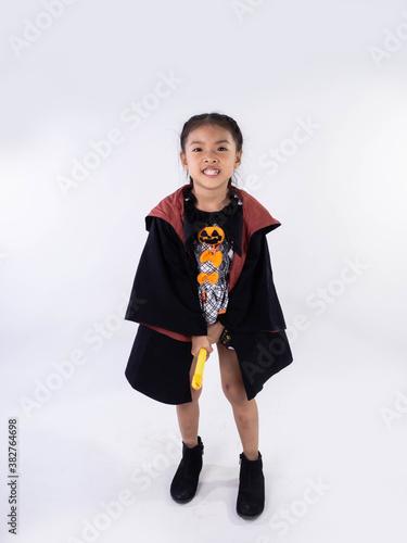 Fotografia, Obraz Asian children girl in witch dress costume Riding a broom for Halloween decorati