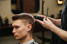 Confident Young Man In A Barber Shop Getting A Trim