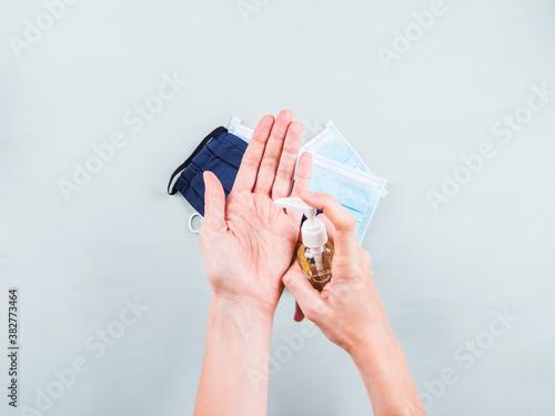 Obraz na plátně New normal rules - wear protective face mask and apply sanitiser gel on your hands