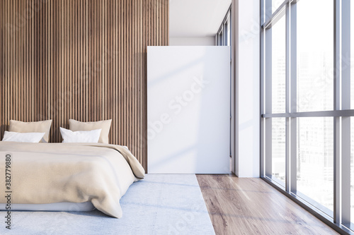 Modern white and dark wooden master bedroom with poster