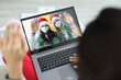 canvas print picture - Young women in protective masks on their faces waving from laptop screen to their friend. Remote communication during covid 19 pandemic concept.