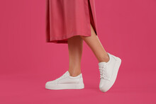 Woman Wearing Shoes On Pink Background, Closeup