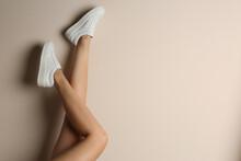 Woman Wearing Shoes On Beige B...