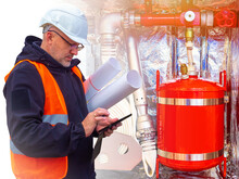 Fire Safety. Checking Fire-fighting Equipment. A Safety Engineer Checks Fire Extinguishers And Hoses.