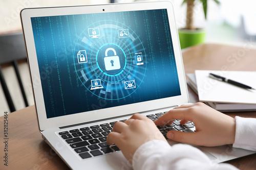 Obraz Cyber security concept. Woman using application on laptop, closeup - fototapety do salonu