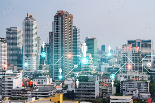 Fototapeta Social media icons hologram over panorama city view of Bangkok, Asia. The concept of people networking and connections. Double exposure.