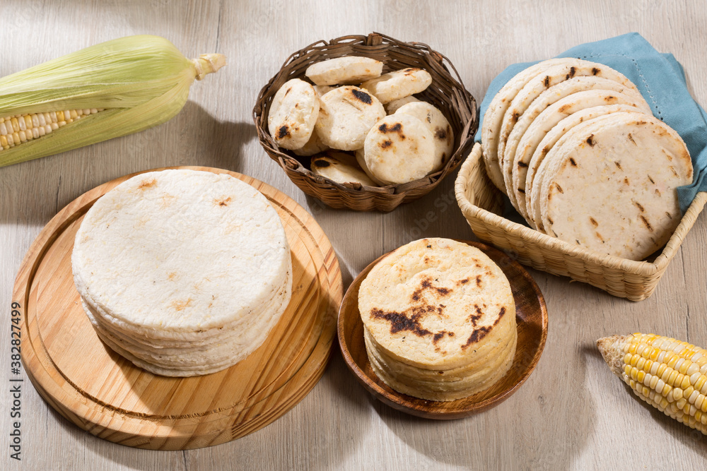 Fototapeta Typical South American food - different types of corn arepas.