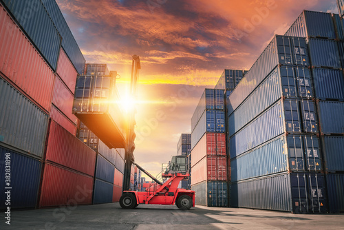 Container Ship Loading of Import/Export Freight Transportation Industry, Transport Crane Forklift is Lifting Box Containers at Port Cargo Shipping Dock Yard Fototapete