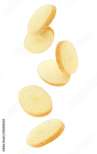 Fotografía Isolated potato pieces in the air