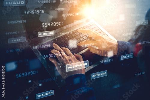 Obraz na plátně Double exposure of hacker hands using a laptop