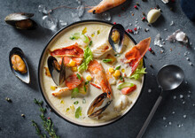 New England Clam Chowder, Occasionally Referred To As Boston Or Boston-style Clam Chowder. Creamy Soup With Shrimp, Corn, Bacon And Mussels