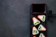 Sushi background. Salmon maki rolls on plate