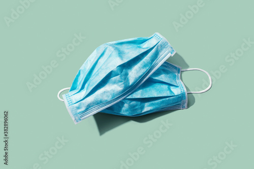 Obraz Blue surgical masks overhead view - flat lay - fototapety do salonu