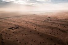 Aerial View Of Light Rays Shining On Sand Dunes Of Arabian Desert In Dubai, UAE
