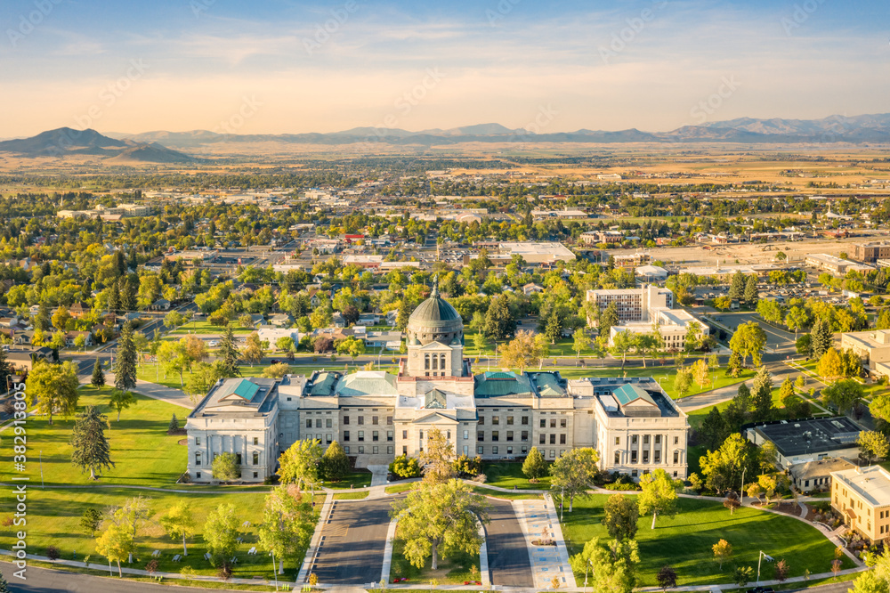 Fototapeta Drone view of the Montana State Capitol, in Helena, on a sunny afternoon with hazy sky caused by wildfires. The Montana State Capitol houses the Montana State Legislature.