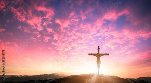 Good Friday concept: Silhouette Jesus Christ and cross over meadow sunset Tableau sur Toile