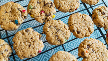 Chocolate Chip Oatmeal Monster Cookies On A Cooling Rack