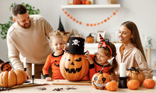 Happy Family Decorates The House, Getting Ready For The Halloween Celebration