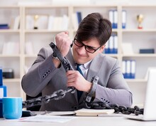 Businessman Tied With Chains T...