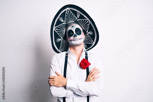 Foto Man wearing day of the dead costume over white skeptic and nervous, disapproving expression on face with crossed arms