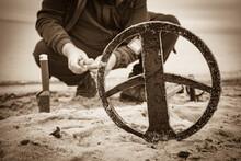 Man With Metal Detector On Sea Beach