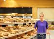 Woman choosing bread from a supermarket.