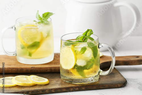 Cups of tasty cold ice tea on table