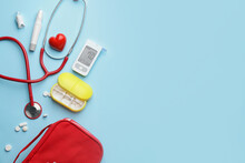 Glucometer With Pills, Stethoscope, Lancet Pen And Heart On Color Background. Diabetes Concept
