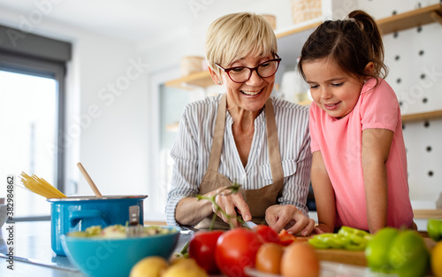 Grandmother and granddaughter are cooking on kitchen Fototapet