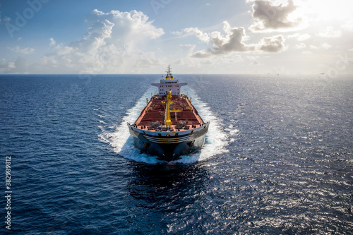 A bulk carrier freight ship traveling with speed over open sea